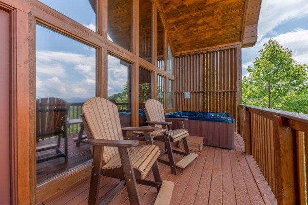 High Adirondack chairs on the deck at Away From it All, a 1 bedroom cabin rental located in Pigeon Forge