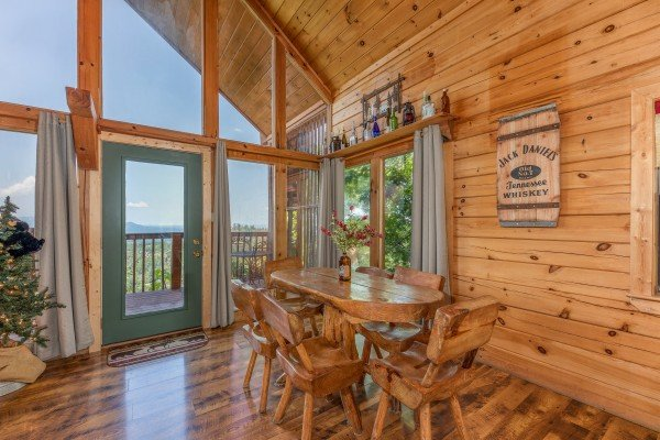 Dining area with seating for six at Away From it All, a 1 bedroom cabin rental located in Pigeon Forge