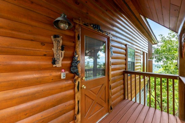 Front door with custom woodwork at Away From it All, a 1 bedroom cabin rental located in Pigeon Forge
