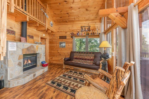Fireplace in the living room at Away From it All, a 1 bedroom cabin rental located in Pigeon Forge