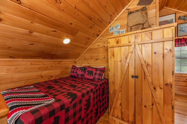 Full sized bed in the loft space at Away From it All, a 1 bedroom cabin rental located in Pigeon Forge