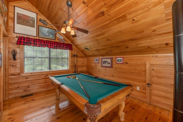 Pool table in the loft at Away From it All, a 1 bedroom cabin rental located in Pigeon Forge