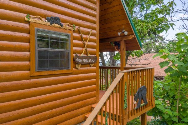 Stairs to the front porch at Away From it All, a 1 bedroom cabin rental located in Pigeon Forge