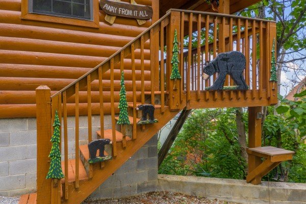 Custom woodwork on the stairs at Away From it All, a 1 bedroom cabin rental located in Pigeon Forge