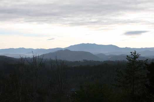 Take in the mountain panorama at Blue Mountain Views, a 1-bedroom cabin rental located in Pigeon Forge
