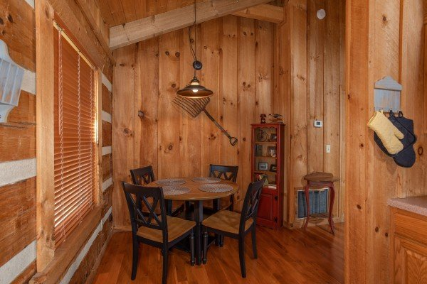 Dining table for four at Blue Mountain Views, a 1 bedroom cabin rental located in  Pigeon Forge
