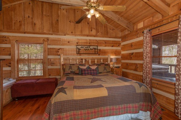 Bedroom with an in room jacuzzi at Blue Mountain Views, a 1 bedroom cabin rental located in  Pigeon Forge