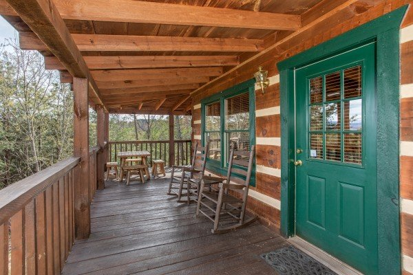 Front porch with rocking chairs at Blue Mountain Views, a 1 bedroom cabin rental located in  Pigeon Forge