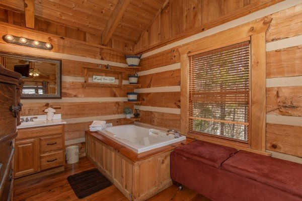 Jacuzzi in the corner of the bedroom at Blue Mountain Views, a 1 bedroom cabin rental located in  Pigeon Forge