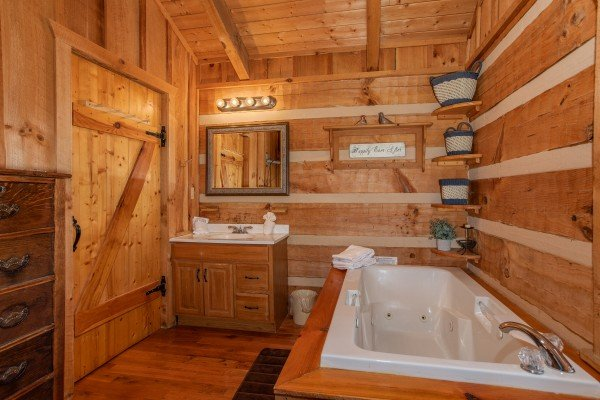 Vanity and jacuzzi tub in the bedroom at Blue Mountain Views, a 1 bedroom cabin rental located in  Pigeon Forge