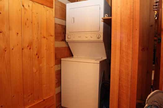 Stacked washer and dryer at Blue Mountain Views, a 1-bedroom cabin rental located in Pigeon Forge