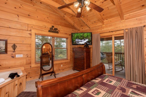 Bedroom with deck access at Awesome Views, a 4-bedroom cabin rental located in Pigeon Forge