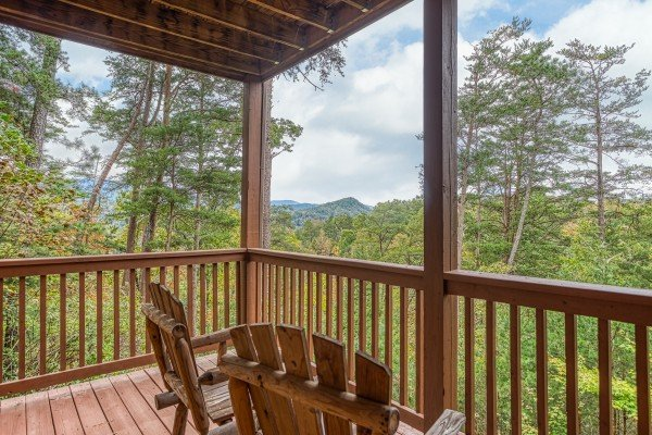 Adirondack chairs on a covered deck at Awesome Views, a 4-bedroom cabin rental located in Pigeon Forge
