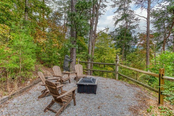 Fire pit with four Adirondack chairs at Awesome Views, a 4-bedroom cabin rental located in Pigeon Forge