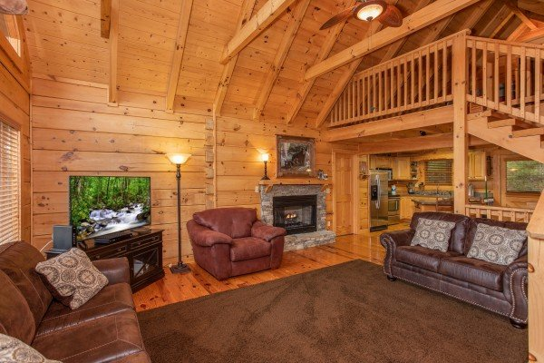 Living room with a couch, chair, and loveseat at Awesome Views, a 4-bedroom cabin rental located in Pigeon Forge