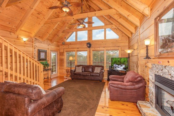 Large windows in the living room at Awesome Views, a 4-bedroom cabin rental located in Pigeon Forge
