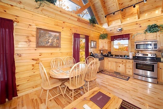 Dining table for six at Bullwinkle's Place, a 1-bedroom cabin rental located in Gatlinburg