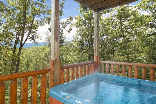 Hot tub on the deck at Bullwinkle's Place, a 1-bedroom cabin rental located in Gatlinburg