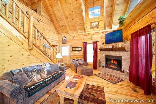 Living room with fireplace at Bullwinkle's Place, a 1-bedroom cabin rental located in Gatlinburg