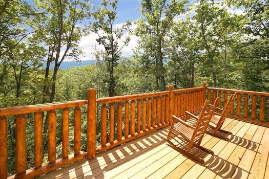rocking chairs on the deck at bullwinkle's place a 1 bedroom cabin rental located in gatlinburg