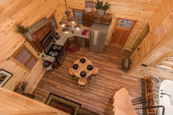 Looking down on to the main floor at Pigeon Forge Treehouse, a 1 bedroom cabin rental located in Pigeon Forge