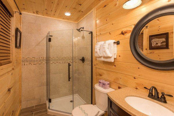 Bathroom with a glassed in shower at Pigeon Forge Treehouse, a 1 bedroom cabin rental located in Pigeon Forge