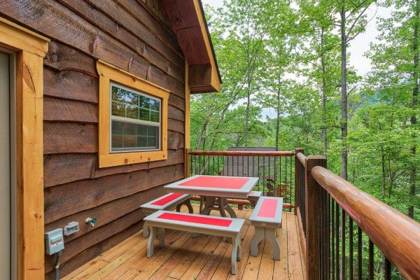 Dining table for four on the deck at Pigeon Forge Treehouse, a 1 bedroom cabin rental located in Pigeon Forge