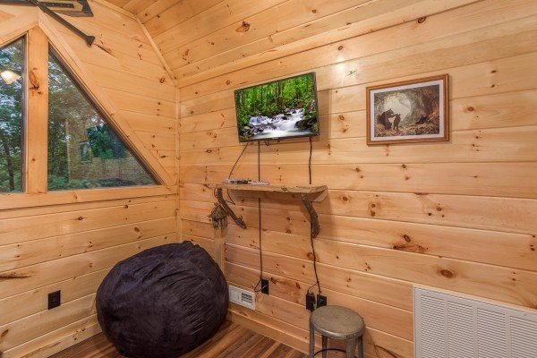 TV and bean bag chair in the loft at Pigeon Forge Treehouse, a 1 bedroom cabin rental located in Pigeon Forge