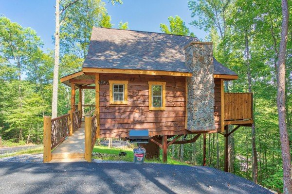 Grill and parking area at Pigeon Forge Treehouse, a 1 bedroom cabin rental located in Pigeon Forge