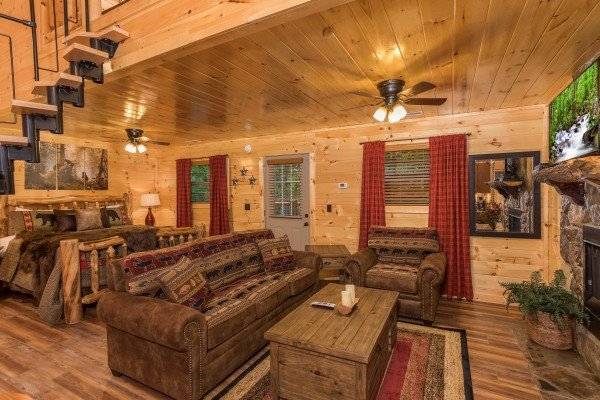 Studio concept main floor with bed and living room at Pigeon Forge Treehouse, a 1 bedroom cabin rental located in Pigeon Forge