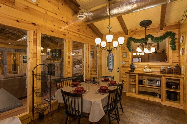 Dining table for six at Rustic Ranch, a 2 bedroom cabin rental located in Pigeon Forge