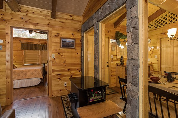 Arcade game and dining table at Rustic Ranch, a 2 bedroom cabin rental located in Pigeon Forge