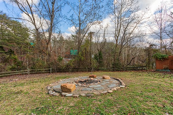 Fire pit at Rustic Ranch, a 2 bedroom cabin rental located in Pigeon Forge