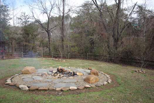 Fire pit and mountain view at Rustic Ranch, a 2 bedroom cabin rental located in Pigeon Forge