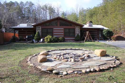 Front exterior with fire pit at Rustic Ranch, a 2 bedroom cabin rental located in Pigeon Forge