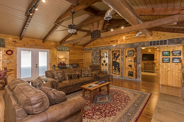 Living room and dining space at Rustic Ranch, a 2 bedroom cabin rental located in Pigeon Forge