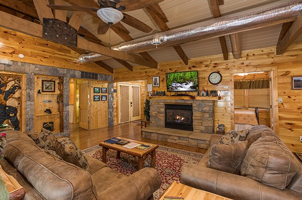 Living room with fireplace and TV at Rustic Ranch, a 2 bedroom cabin rental located in Pigeon Forge
