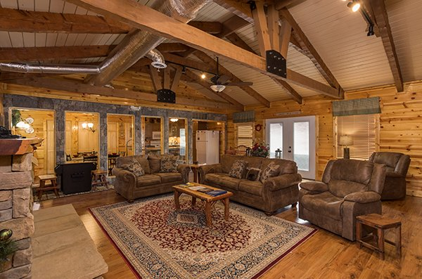 Living room seating at Rustic Ranch, a 2 bedroom cabin rental located in Pigeon Forge