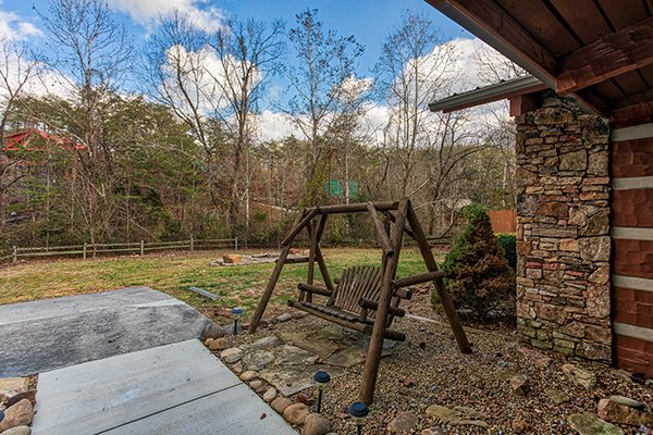 Swing in the yard at Rustic Ranch, a 2 bedroom cabin rental located in Pigeon Forge