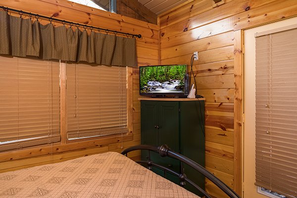 Queen bedroom with dresser and TV at Rustic Ranch, a 2 bedroom cabin rental located in Pigeon Forge