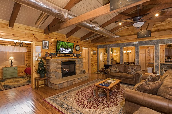 Living room with vaulted ceiling at Rustic Ranch, a 2 bedroom cabin rental located in Pigeon Forge