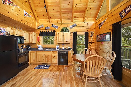 Kitchen and dining space at Nascar Nation, a 2 bedroom cabin rental located in Pigeon Forge