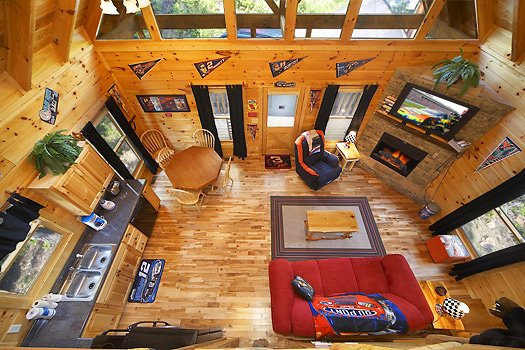 Looking down onto the living room from the upper floor at Nascar Nation, a 2 bedroom cabin rental located in Pigeon Forge
