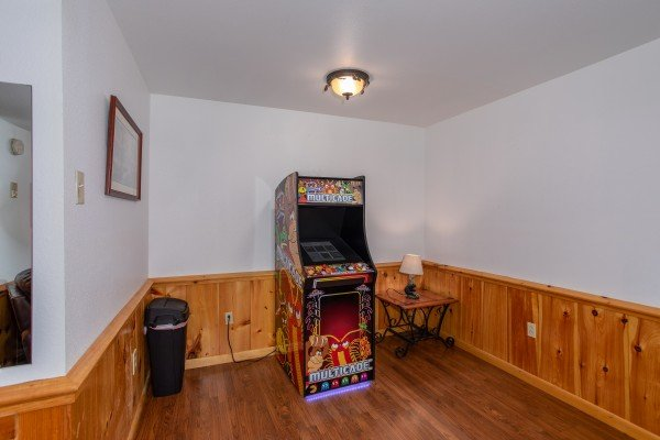 Lower level living room arcade game at Oh The View, a 3-bedroom cabin rental located in Pigeon Forge
