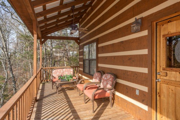 Two chairs and a loveseat on the deck at Oh The View, a 3-bedroom cabin rental located in Pigeon Forge