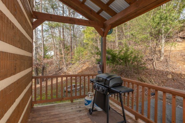 Propane grill on the covered deck at Oh The View, a 3-bedroom cabin rental located in Pigeon Forge