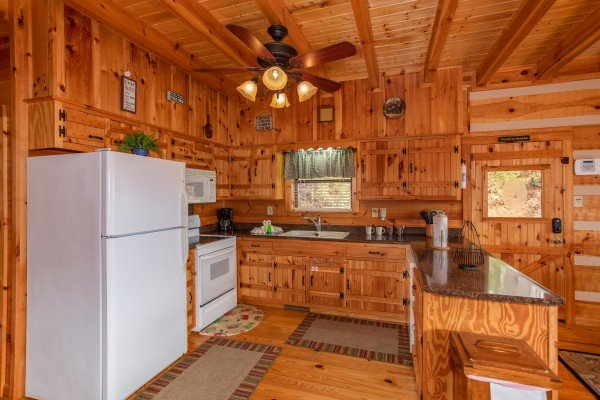 Kitchen with white appliances at Oh The View, a 3-bedroom cabin rental located in Pigeon Forge