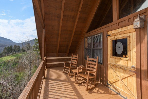 Upper deck off the loft level at Oh The View, a 3-bedroom cabin rental located in Pigeon Forge