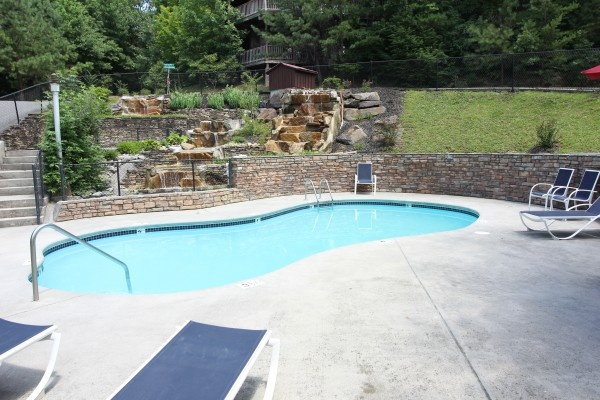 Relax by the resort pool while staying at Tranquil View, a 1 bedroom cabin rental located in Gatlinburg