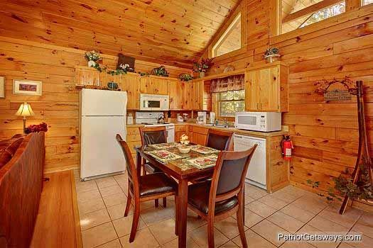 eat in kitchen with table at tranquil view a 1 bedroom cabin rental located in gatlinburg